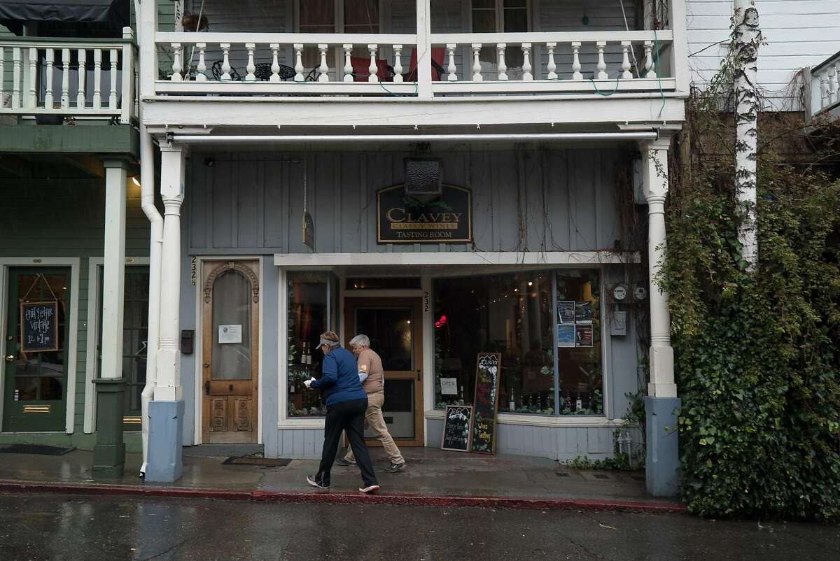 Two women walk past the Clavey tasting room in Nevada City, Calif. on Sunday, March 6, 2016. Clavey wines is located in downtown.