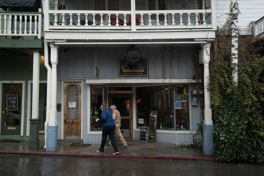 Two women walk past the Clavey Winery tasting room on Commercial Street in Nevada City. Photo: James Tensuan, Special To The Chronicle