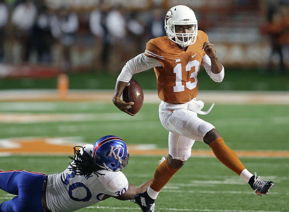 Longhorns quarterback Jerrod Heard skips a tackle as Texas hosts Kansas at Royal-Memorial Stadium in Austin on Nov. 7, 2015.