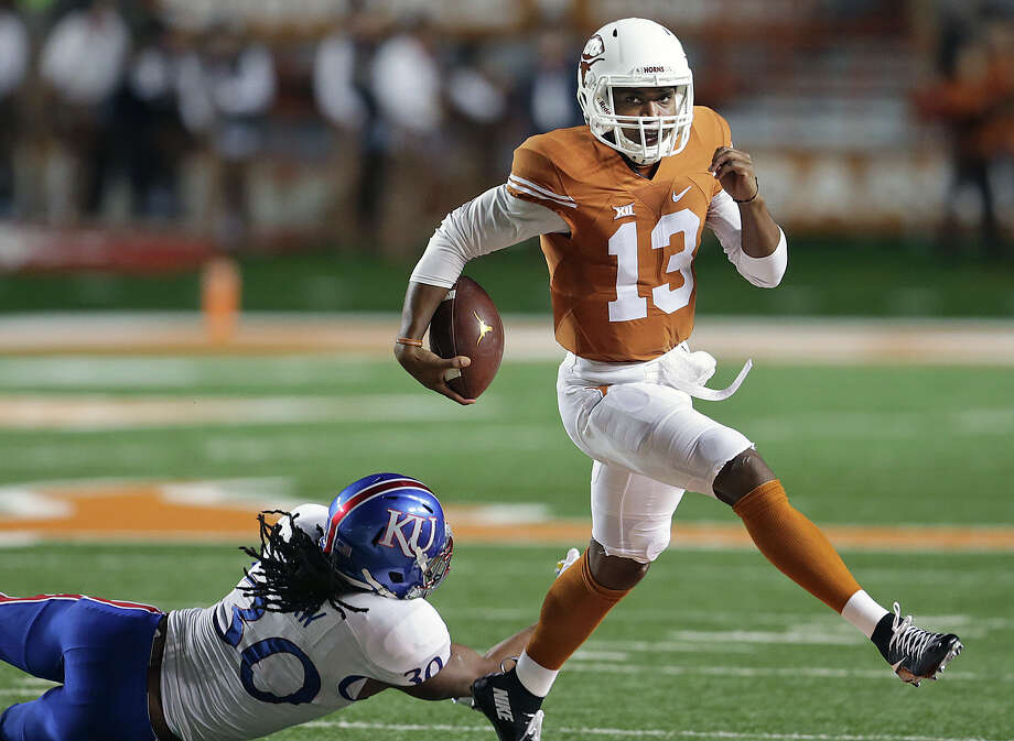 Longhorns quarterback Jerrod Heard skips a tackle as Texas hosts Kansas at Royal-Memorial Stadium in Austin on Nov. 7, 2015. Photo: Tom Reel /San Antonio Express-News / 2015 SAN ANTONIO EXPRESS-NEWS