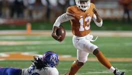 Longhorns quarterback Jerrod Heard skips a tackle as Texas hosts Kansas at Royal-Memorial Stadium in Austin on Nov. 7, 2015.