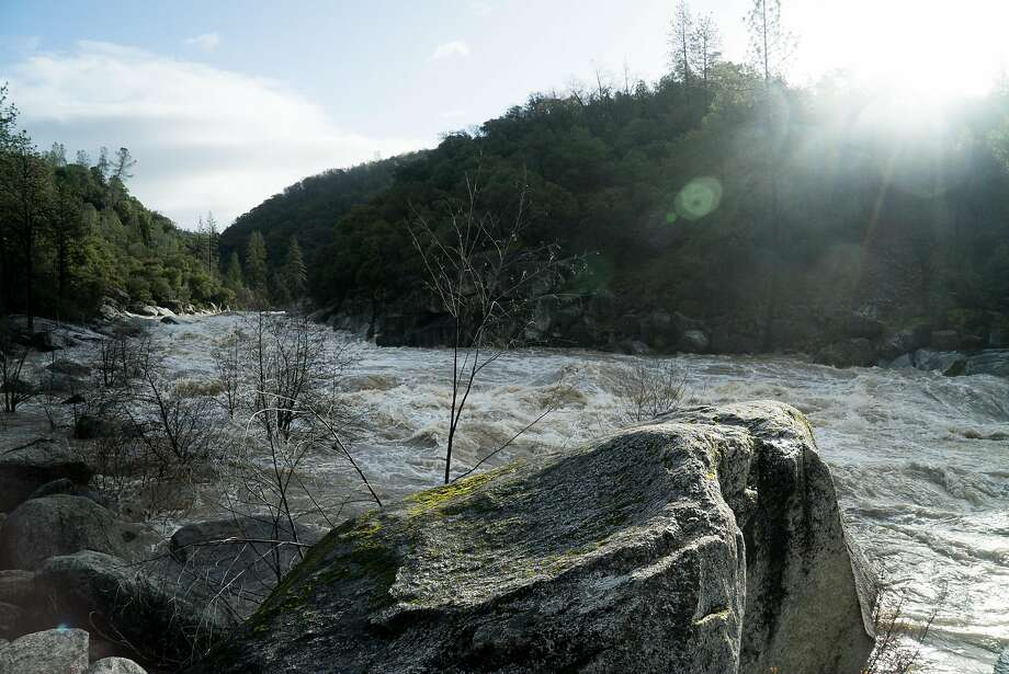 Man plucked from raging California river in dramatic video