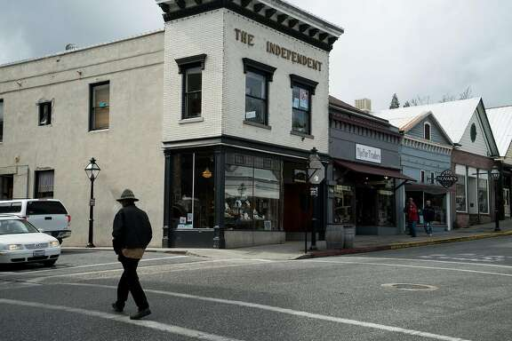 A man walks through downtown Nevada City, Calif. on Sunday, March 6, 2016. Nevada City offers activities ranging from fine dining to outdoor adventure.