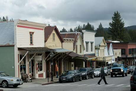 A man walks through downtown Nevada City. Photo: James Tensuan, Special To The Chronicle
