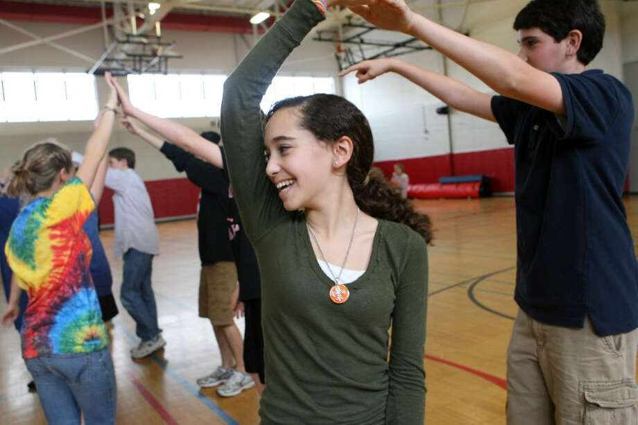 """Fairfield Warde freshmen Sarah Zeisler, left, and  dance partner Devin Pulton take a Caribbean Moves class during the school's annual """"Warde Day"""" on Friday, April 9, 2010. The day is filled with diverse and cultural activities. Photo: B.K. Angeletti / Connecticut Post"""
