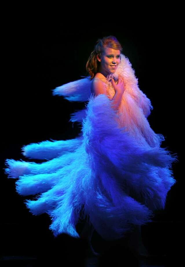 """Seventeen-year-old, lead actress Amber Carpenter dances with giant fans made out of ostrich feathers and made to the same size and specification of the fans used by the burlesque dancer Sally Rand during the production """"Fandance, The Life of Sally Rand"""" Friday Apr. 2, 2010 at the Downtown Cabaret Theatre in Bridgeport. Photo: Autumn Driscoll / Connecticut Post"""