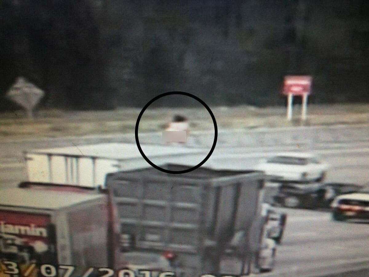 A naked woman dances on top of a big rig Monday, March 7, on US-290 near Huffmeister.