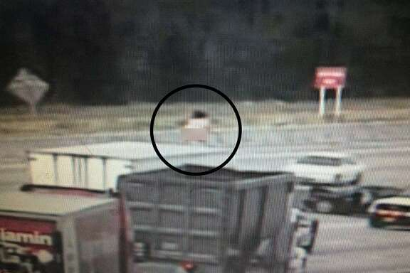 A naked woman dancing on top of a big rig further complicated a traffic accident Monday, March 7, 2016 of US-290 near Huffmeister in Houston.