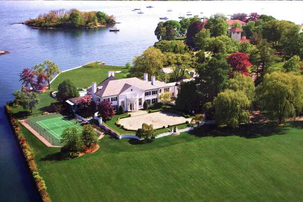 An aerial photo of the home that was once owned by Donald Trump at 21 Vista Drive in Greenwich, Conn., Thursday, Jan. 15, 2015, is now on the market with an asking price of $54 million. The waterfront mansion sits on roughly 6 acres of land near the tip of Indian Harbor Point on Long Island Sound.