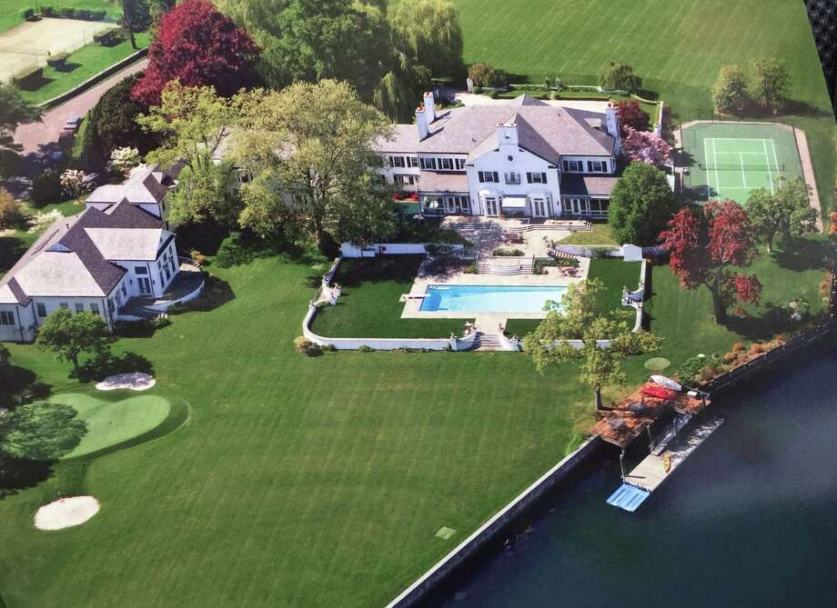 A 2015 aerial photo of the home that was once owned by Donald Trump at 21 Vista Drive in Greenwich. The house is on the market for $54 million. The waterfront mansion sits on roughly 6 acres of land near the tip of Indian Harbor Point. Photo: Bob Luckey / Contributed / Greenwich Time