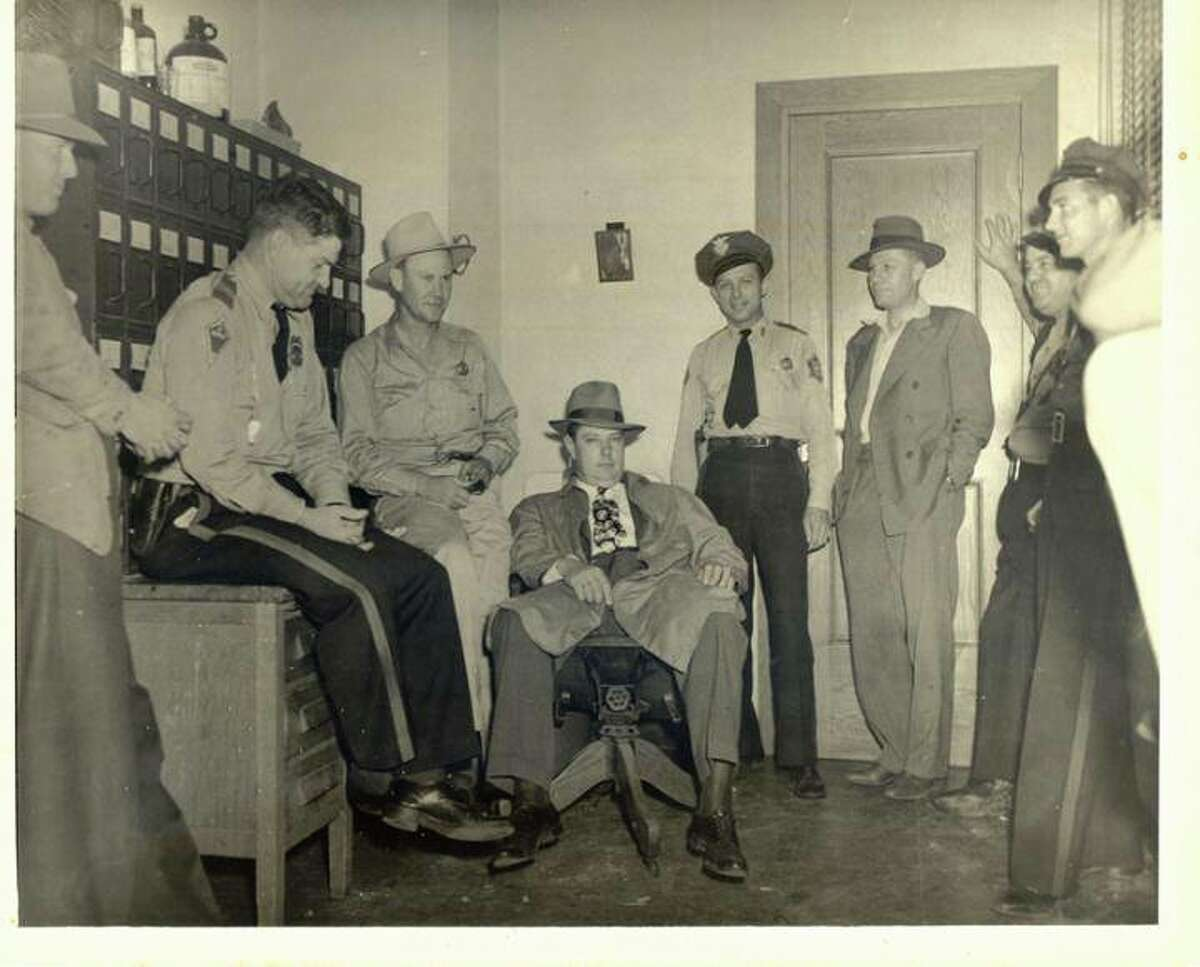 Pictured, officers working the Phantom Killer case in 1946 gathered in the Miller County Sheriff's office.