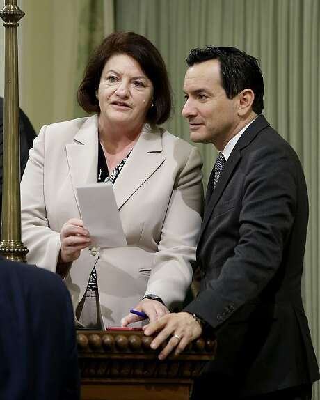 Speaker Toni Atkins hands reins to Anthony Rendon. Photo: Rich Pedroncelli, AP