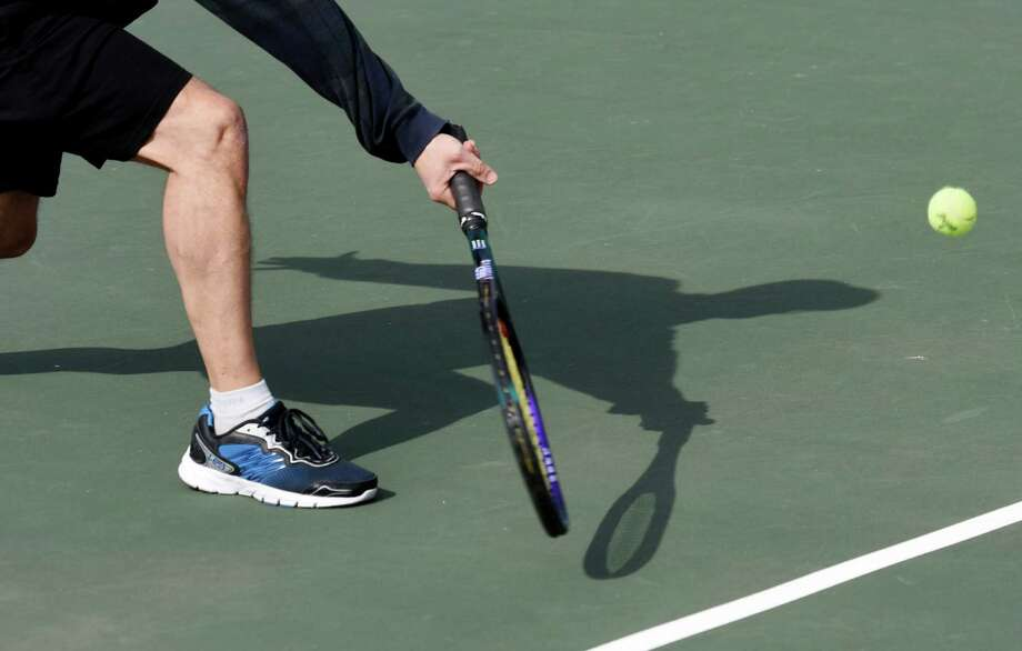 Roger Revel, of Old Greenwich, returns a shot while playing tennis for the first time this year at the Binney Park tennis courts in Old Greenwich, Conn. Monday, March 7, 2016. Monday was a sunny, blustery day reaching the mid-50s, and temperatures Tuesday and Wednesday are expected to soar even higher into the mid- to upper-60s. Photo: Tyler Sizemore Tyler Sizemore, Hearst Connecticut Media / Greenwich Time