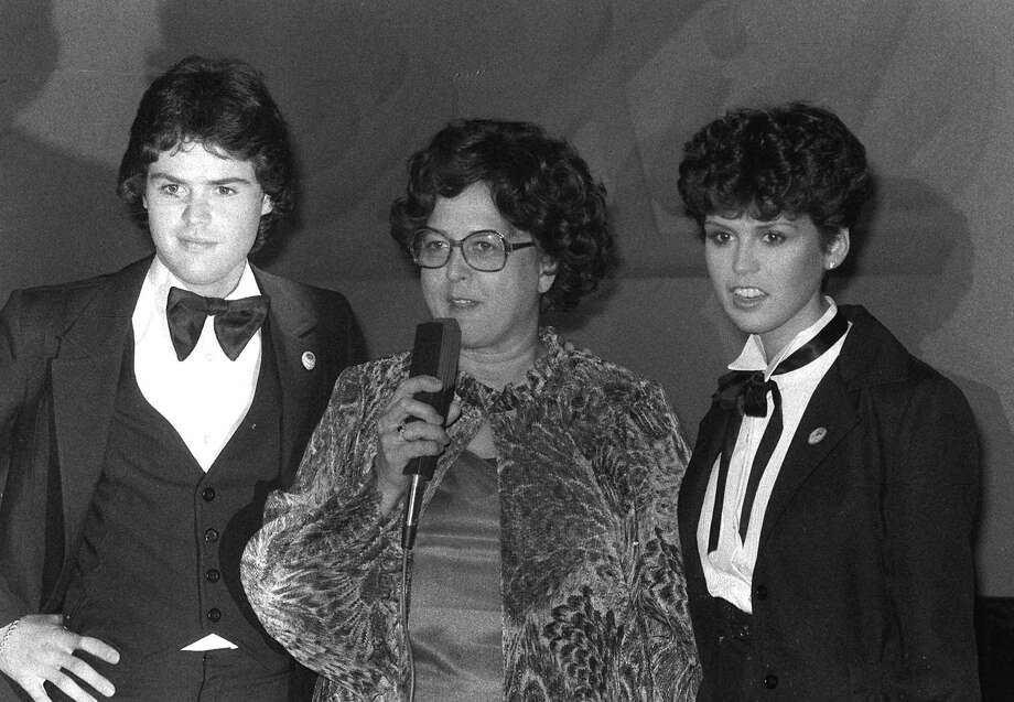 "Donny and Marie Osmond get together in New York, Monday, July 25, 1978, with their mother, Olive, during a showing of young people's fashions designed by Mrs. Osmond. Donny and Marie wear a couple of the outfits from the line called ""Olive's Kids."" The show was at Manhattan's New York, New York disco. (AP Photo) Photo: ASSOCIATED PRESS / AP1978"