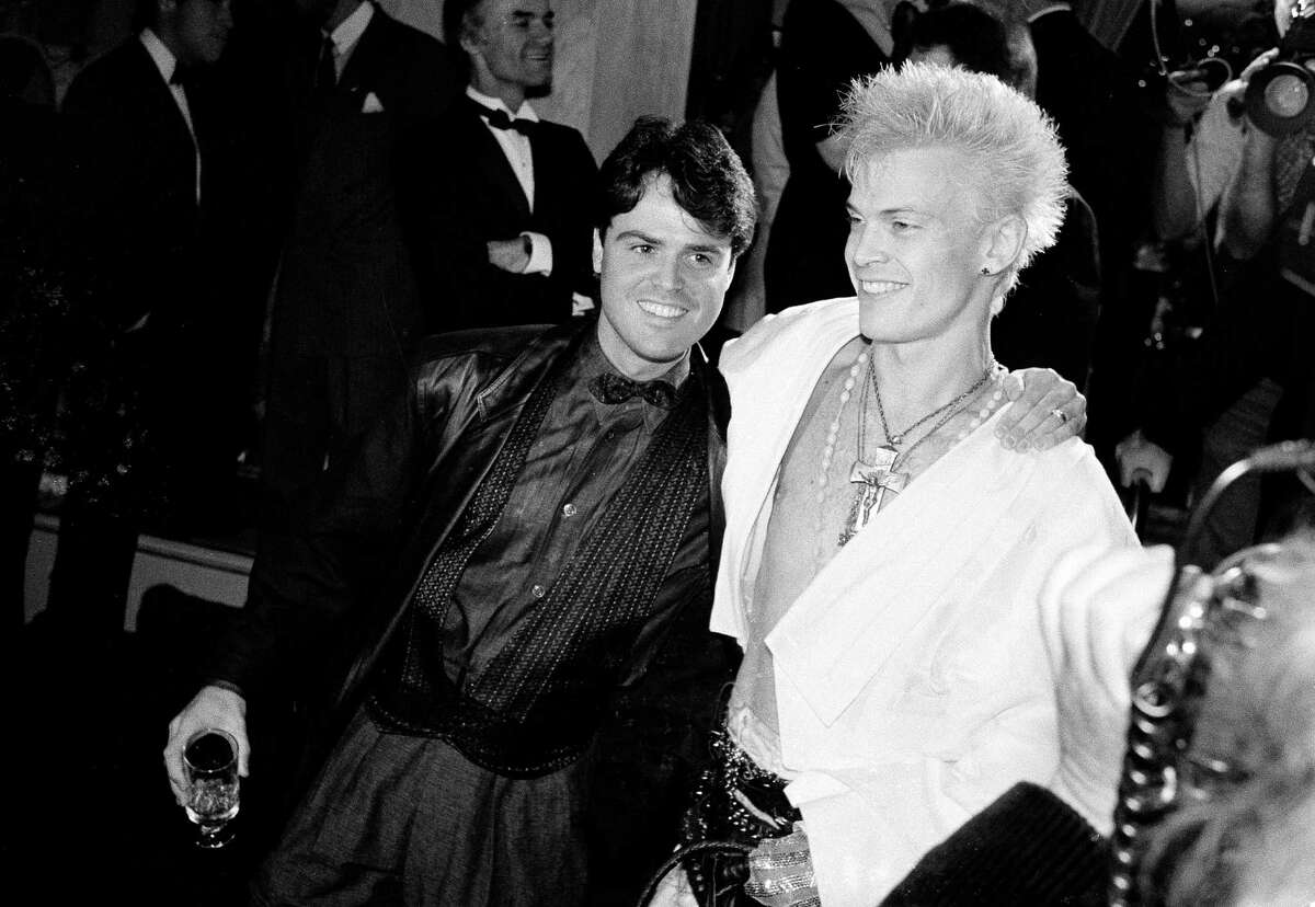 Pop singer Donny Osmond, left, and new wave singer Billy Idol share a moment at the second annual A.S.C.A.P. Pop Music Awards in Beverly Hills, Calif., May 2, 1985.