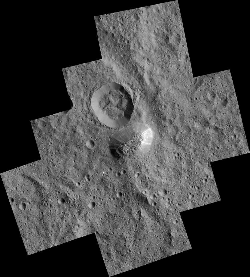 NASA caption (zoomable version in story below): Ceres' mysterious mountain Ahuna Mons is seen in this mosaic of images from NASA's Dawn spacecraft. Dawn took these images from its lowest-altitude orbit.