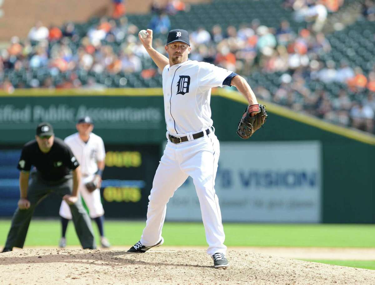 DETROIT, MI - MAY 22: Danny Worth #29 of the Detroit Tigers pitches during the game against the Texas Rangers at Comerica Park on May 22, 2014 in Detroit, Michigan. The Rangers defeated the Tigers 9-2.