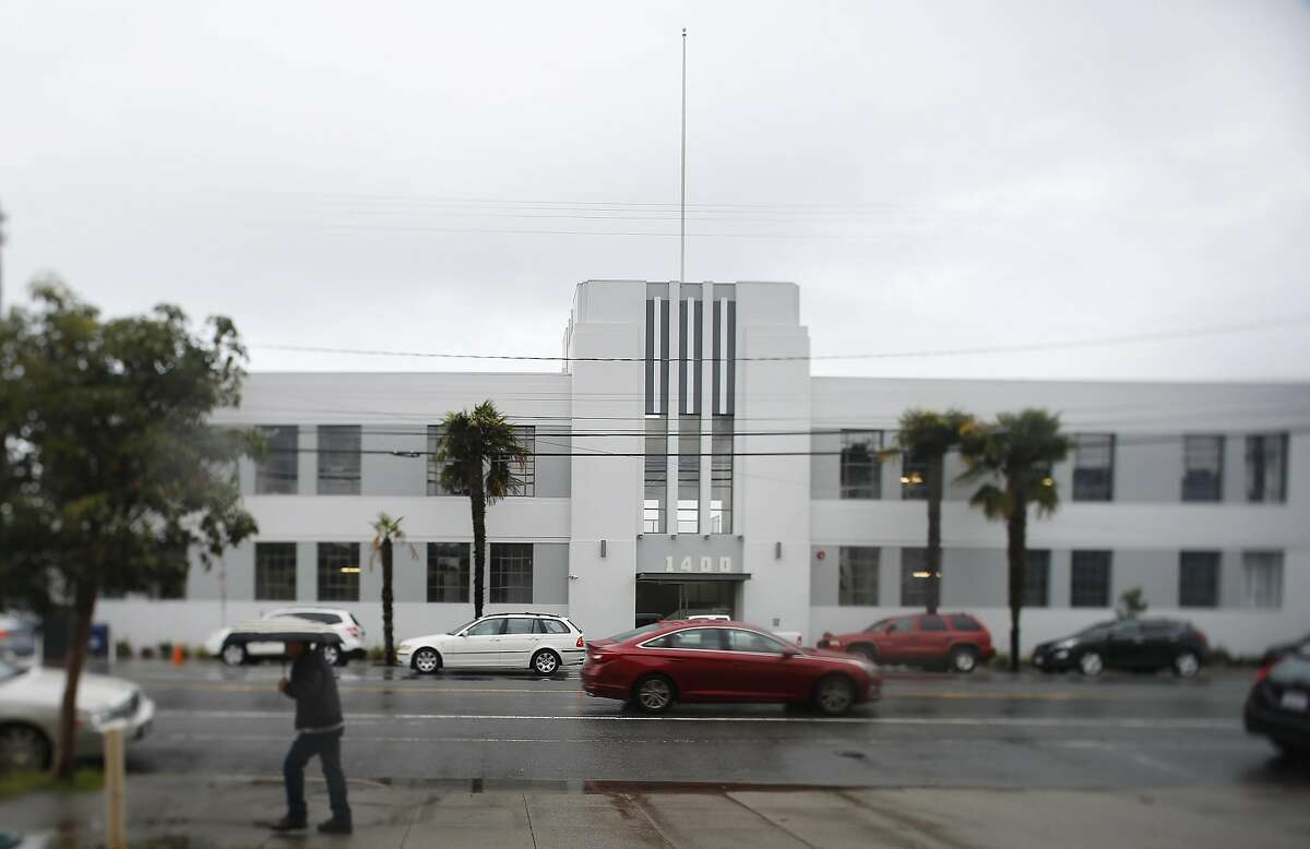 A pedestrian walks past the McClintock Building at 1400 16th Street on Monday, March 7, 2016 in San Francisco, California.