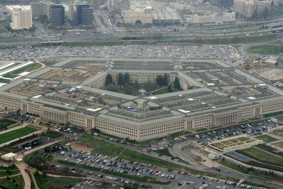 "File - The Pentagon is seen in this aerial view in Washington, in this March 27, 2008 file photo. The WikiLeaks website appears close to releasing what the Pentagon fears is the largest cache of secret U.S. documents in history _ hundreds of thousands of intelligence reports compiled after the 2003 invasion of Iraq. In a message posted to its Twitter page on Thursday Oct. 21, 2010, the organization said there was a ""major WikiLeaks press conference in Europe coming up.""  (AP Photo/Charles Dharapak, File)"