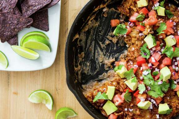 Mad Mex, inspired by unexpected best picture nominee éMad Max: Fury Road.é a a take on a party favorite, the 7-layer dip. From the book, Cook It in Cast Iron by Cook's Country.
