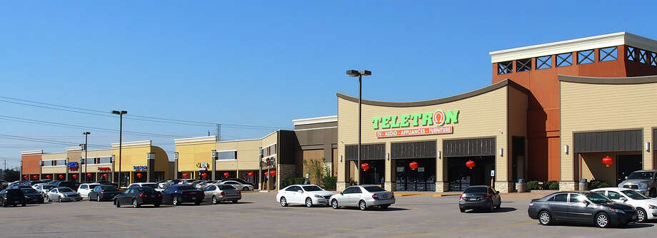 Whitestone REIT recently completed the redevelopment of its Lion Square shopping center at  Bellaire and Wilcrest in southwest Houston. The company is focusing on neighborhood shopping centers and is selling some non-core assets. / NHAN NGUYEN