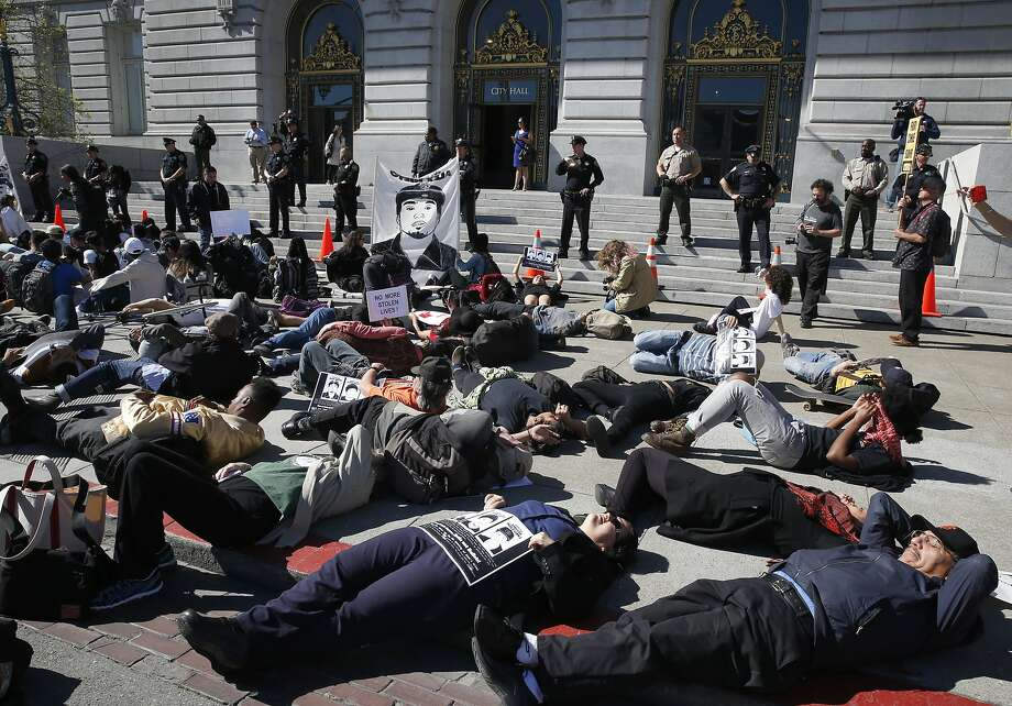 Protesters demanding justice for Alex Nieto stage a die-in in front of City Hall in San Francisco, Calif. on Tuesday, March 1, 2016. Jury selection and opening arguments were scheduled to get underway Tuesday in a federal civil rights trial against four police officers who shot and killed Alex Nieto in Bernal Heights Park nearly two years ago. Photo: Paul Chinn, The Chronicle