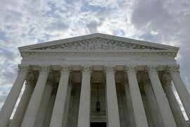 (FILES) This file photo taken on August 1, 2015 shows the US Supreme Court in Washington, DC.  The US Supreme Court on March 7, 2016 upheld a ruling that Apple was part of a price-fixing conspiracy for electronic books, clearing the way for a $450 million settlement to be paid. The top court declined without comment to hear an appeal from Apple, which lets stand a 2013 ruling by a New York federal judge.  / AFP / KAREN BLEIERKAREN BLEIER/AFP/Getty Images
