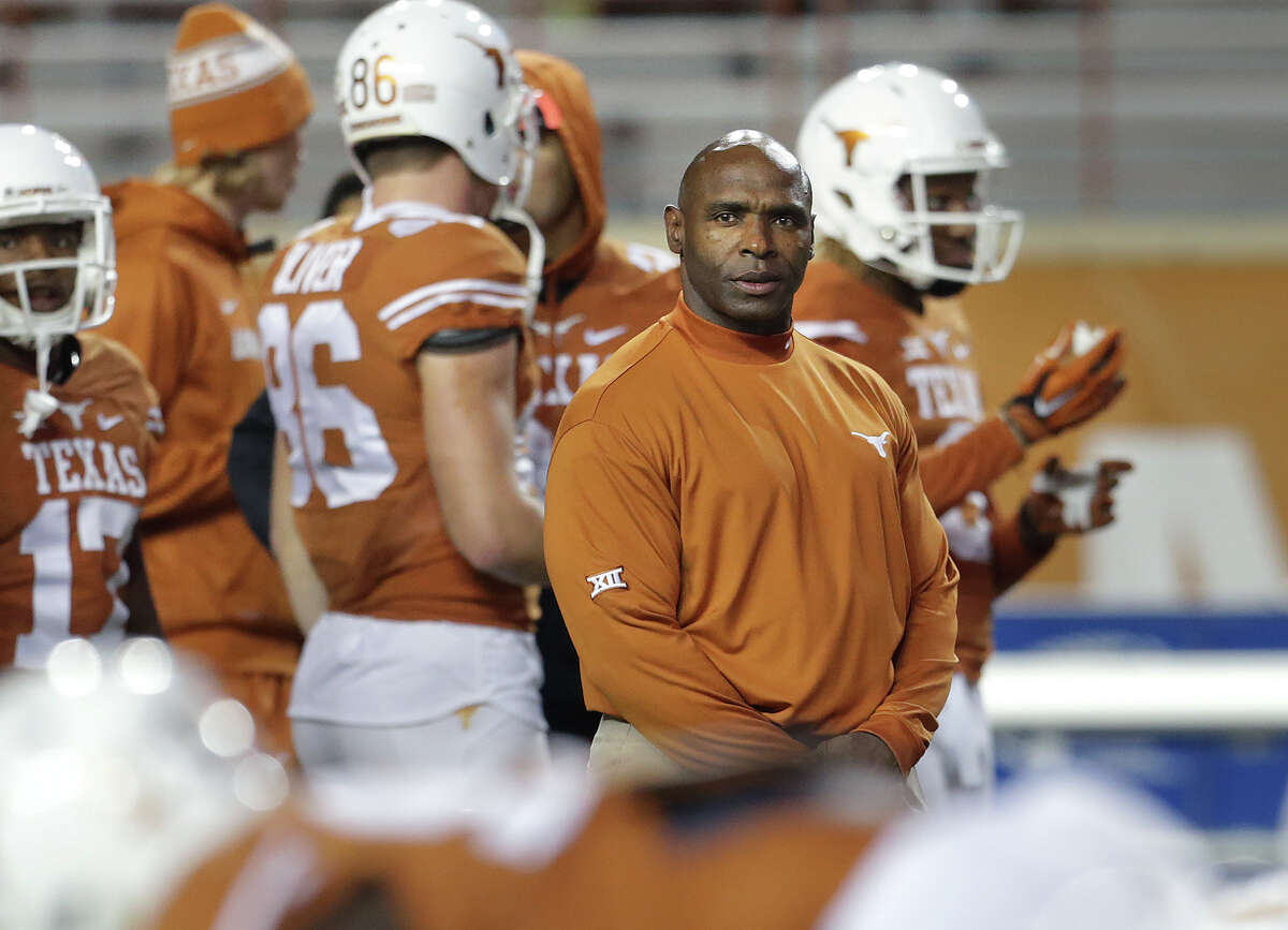 Longhorns coach Charlie Strong looks over his players during pre game warmup as Texas hosts Kansas at Royal-Memorial Stadium on Nov. 7, 2015.