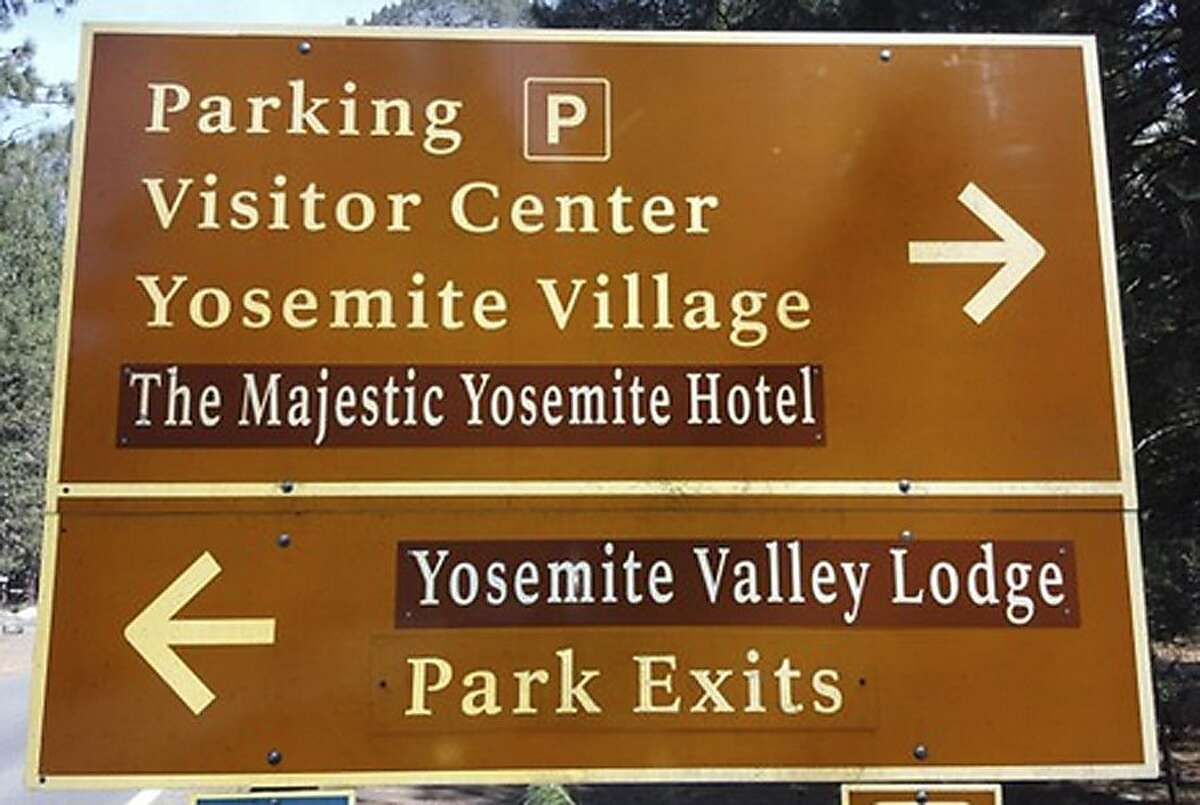 A traffic sign is seen with changes to reflect new names for The Ahwahnee Hotel and Yosemite Lodge at the Falls on Tuesday, March 1, 2016, in Yosemite National Park, California. The prices of Yosemite National Park souvenirs have been slashed in half, and road signs directing visitors to iconic attractions have been switched. The changes took place at midnight Monday amid a bitter legal dispute between government officials and Delaware North, which operated many of the popular attractions from 1993 until Monday when competitor Aramark took over. (Rory Appleton/The Fresno Bee via AP) LOCAL PRINT OUT (VISALIA TIMES-DELTA, REEDY EXPONENT, KINGBURG RECORDER, SELMA ENTERPRISE, HANFORD SENTINEL, PORTERVILLE RECORDER, MADERA TRIBUNE, THE BUSINESS JOURNAL FRENSO); LOCAL TELEVISION OUT (KSEE24, KFSN30, KGE47, KMPH26); MANDATORY CREDIT