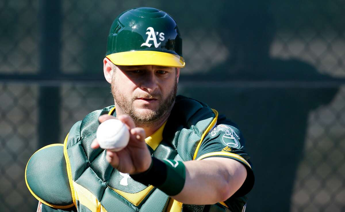 Oakland Athletics catcher Stephen Vogt works on a drill during a spring baseball practice in Mesa, Ariz., Sunday, Feb. 21, 2016. (AP Photo/Chris Carlson)