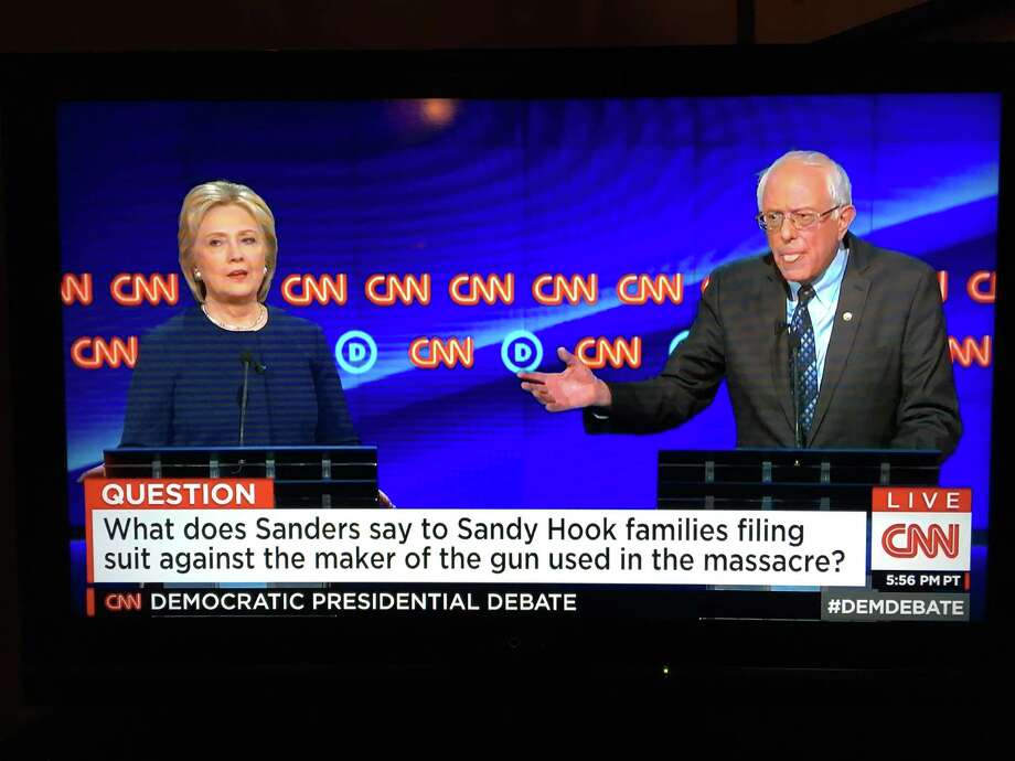 Former Secretary of State Hillary Clinton and U.S. Sen. Bernie Sanders of Vermont clashed over legislation that allows victims of gun violence to sue firearms manufacturers during a CNN Democratic presidential debate Sunday, March 6, 2016. Still photo from CNN broadcast. Photo: Contributed Photo / Still Photo CNN