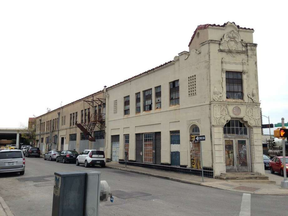 Here is the current empty building at 901 E Houston Street in downtown San Antonio. Click forward to see what each side of this space could look like if the Hilton hotel plan is approved. Photo: Public Documents From The Historic And Design Review Commission