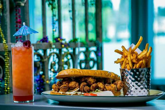 "The fried Shrimp Po Boy with fries  and ""Devilcat"" cocktail at Bywater in Los Gatos, Calif. is seen on March 6th, 2016."