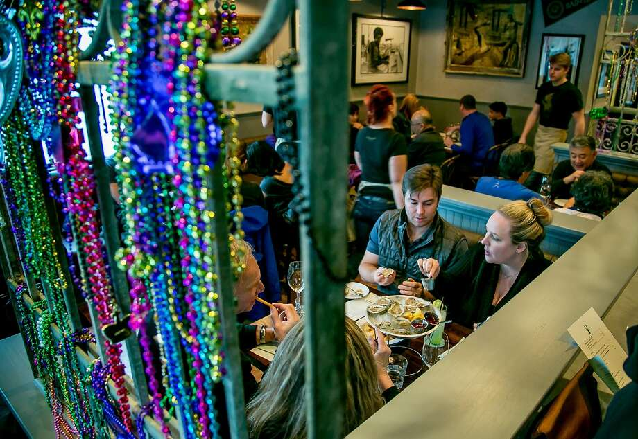 Mardi Gras beads greet diners at the Bywater in Los Gatos. Photo: John Storey John Storey, Special To The Chronicle