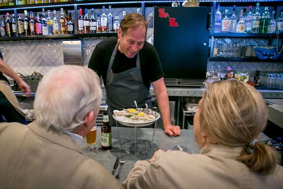 Chef David Kinch talks with customers during dinner service at Bywater in Los Gatos, Calif. on March 6th, 2016.