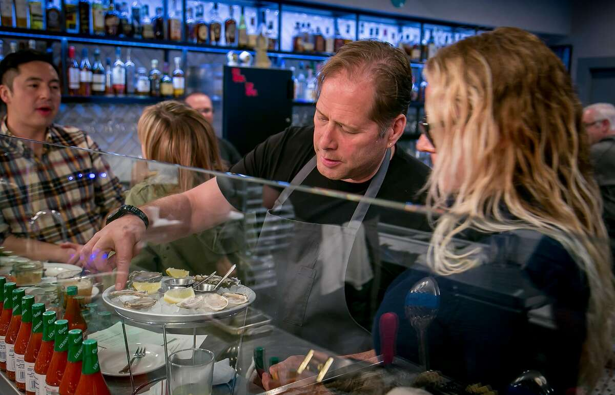 Chef David Kinch shows Judith Manning which oysters are which at Bywater in Los Gatos, Calif. on March 6th, 2016.