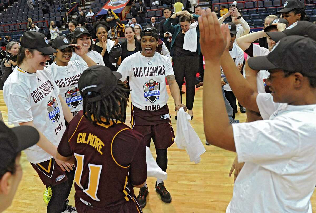 Iona players celebrate after beating Quinnipiac 57-41 in the MAAC women's championship game at the Times Union Center on Monday, March 7, 2016 in Albany, N.Y.