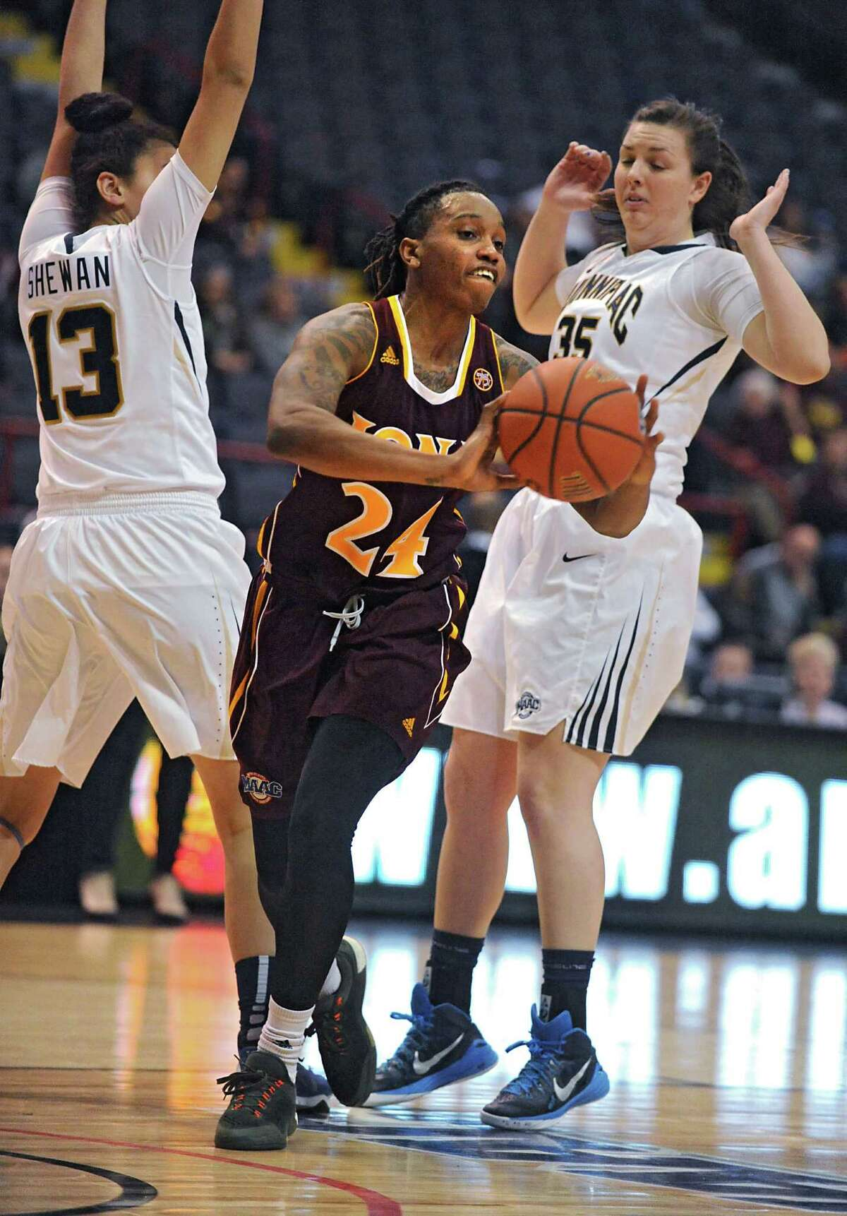 Iona's Joy Adams, center, is able to get a pass off as she is heavily covered by Quinnipiac's Sarah Shewan, left, and Morgan Manz in the MAAC women's championship game at the Times Union Center on Monday, March 7, 2016 in Albany, N.Y. (Lori Van Buren / Times Union)