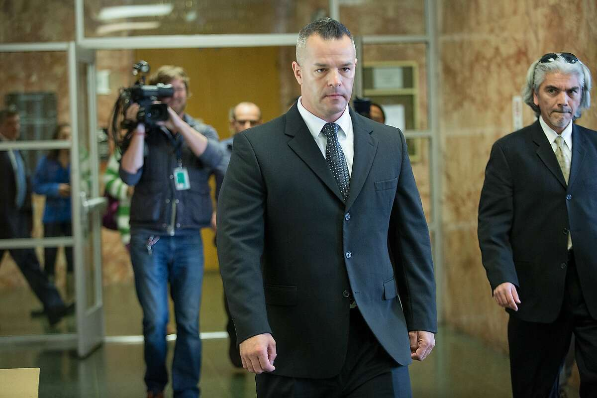 Former San Francisco Sheriff's Deputy Scott Neu makes his way towards the exit after his court appearance at the Hall of Justice, March 7, 2016, in San Francisco, Calif. Neu, 42, pleaded not guilty of allegedly staging gladiator-style fights between inmates.