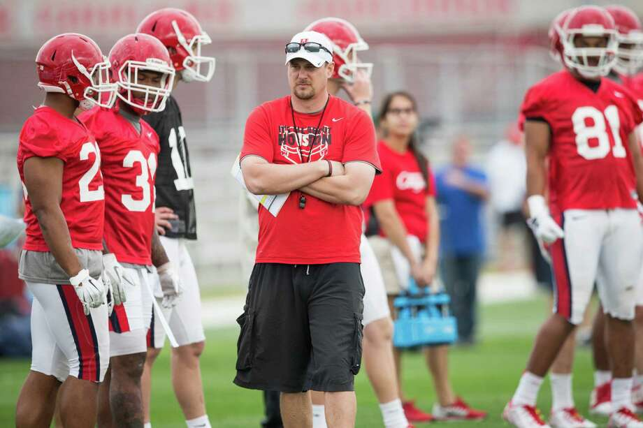 Houston head coach Tom Herman looks on as his players warm up during the Cougars' opening spring practice Monday, March 7, 2016, in Houston. Photo: Brett Coomer, Houston Chronicle / © 2016 Houston Chronicle