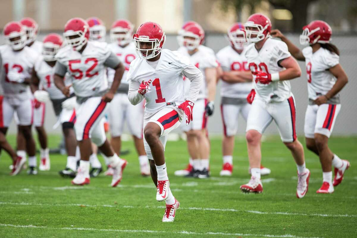 during the Cougars' opening spring practice Monday, March 7, 2016, in Houston.