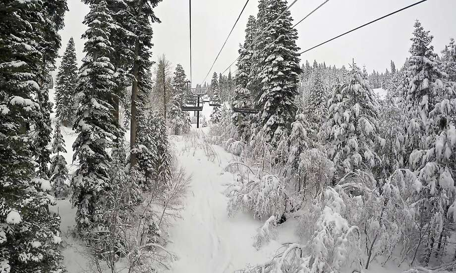 The Promised Land Express ski lift at the Northstar California Resort is surrounded by snow on Monday, March 7, 2016 in Truckee, Calif. A new storm on the way is expected to bring heavy rain and threaten to make the Truckee River flood its banks. Photo: AP