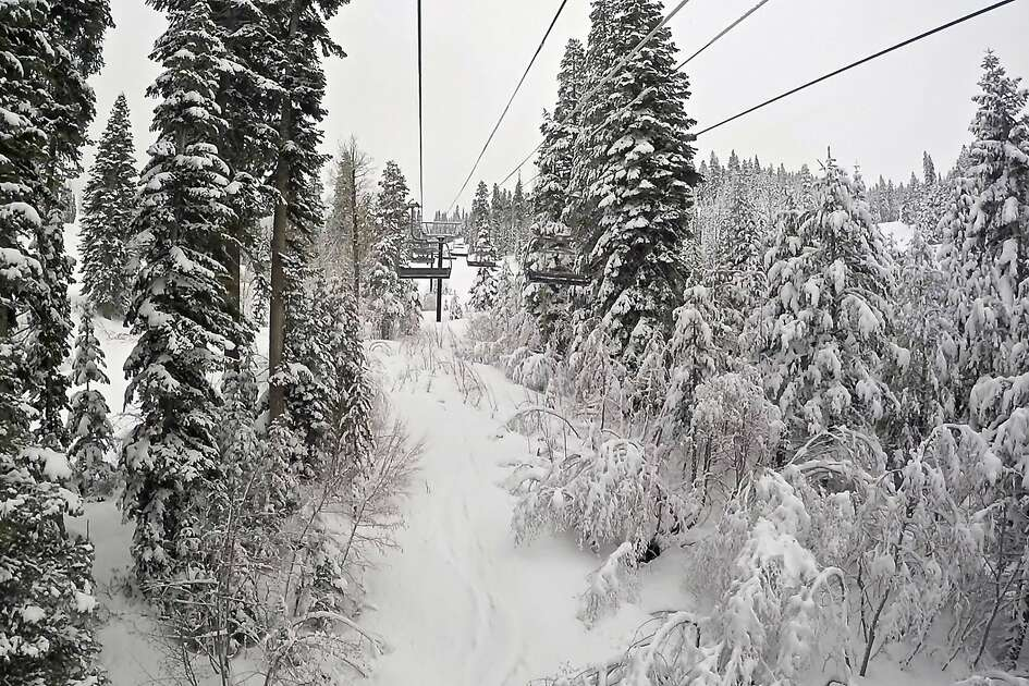 In this photo provided by Northstar California Resort, the Promised Land Express ski lift is surrounded with snow at Northstar California Resort, Monday, March 7, 2016 in Truckee, Calif. Powerful thunderstorms raged throughout California on Monday, walloping the Sierra Nevada with blizzard conditions and briefly knocking out power at the Los Angeles airport. In the Sierra Nevada, a blizzard forced authorities to close Interstate 80 at Donner Summit for several hours overnight. Forecasters warned of whiteout conditions as up to 2 inches of snow fell each hour. The resort says they have received 375 inches of snow this season to date. (Northstar California Resort via AP)