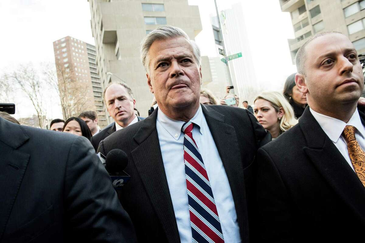 Dean Skelos, the former New York State Senate majority leader, and his son Adam Skelos, right, leave federal court after being found guilty on all counts at their corruption trial in New York, Dec. 11, 2015. Skelos is reported to have pressured Physicians' Reciprocal Insurer's Anthony Bonomo to give his son what amounted to a no-show job (New York Times photo)