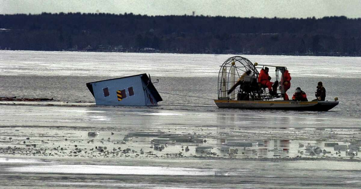 Environmental Conservation officers and State Forest Rangers use an air boat to try and pull up a partially submerged ice fishing shanty on the north end of Saratoga Lake Wednesday morning February 8, 2006. They were unable to pull the shanty free but did manage to move it from navigation channel. This was one of six shantys through the ice that they checked today.