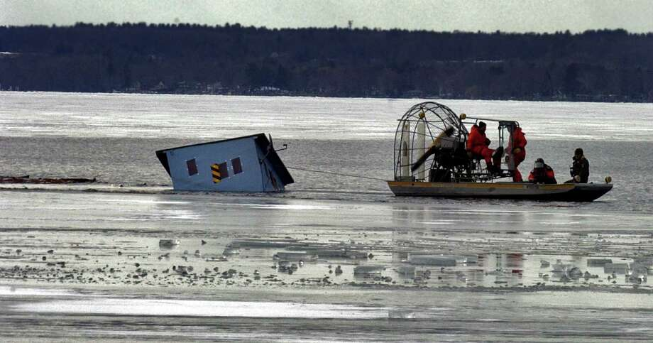 Environmental Conservation officers and State Forest Rangers use an air boat to try and pull up a partially submerged ice fishing shanty on the north end of Saratoga Lake Wednesday morning February 8, 2006. They were unable to pull the shanty free but did manage to move it from navigation channel. Tomorrow, March 15, 2018, is the deadline to remove shanties from lakes and ponds in New York Photo: John Carl D'Annibale / Albany Times Union