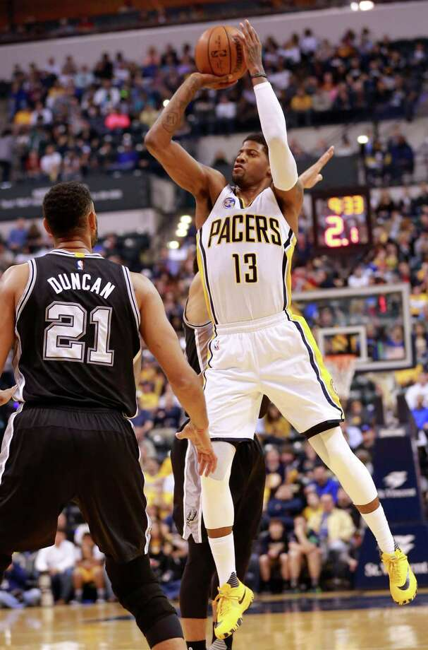 Indiana Pacers forward Paul George (13) shoots the basketball over San Antonio Spurs forward Tim Duncan (21) in the first half of an NBA basketball game, Monday, March 7, 2016, in Indianapolis. (AP Photo/R Brent Smith) Photo: R Brent Smith, Associated Press / FR171017 AP