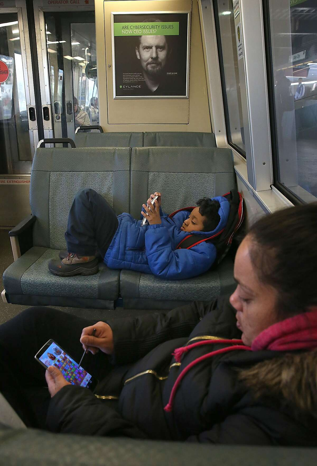 Teresa Fields (front) and her son Terronnie Fields (middle), 7 years old, head home on a near empty train from the Daly City bart station in Daly City, California, on Monday, March 7, 2016.