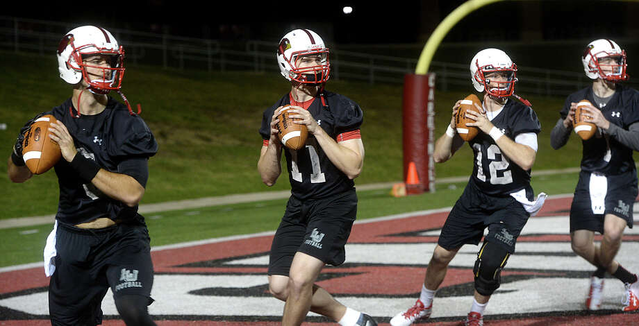 Lamar University's potential quarterback pool gets in practice on the first day of spring practice at Provost-Umphrey Stadium Monday.  Photo taken Monday, March 7, 2016 Kim Brent/The Enterprise Photo: Kim Brent Kim Brent / Beaumont Enterprise