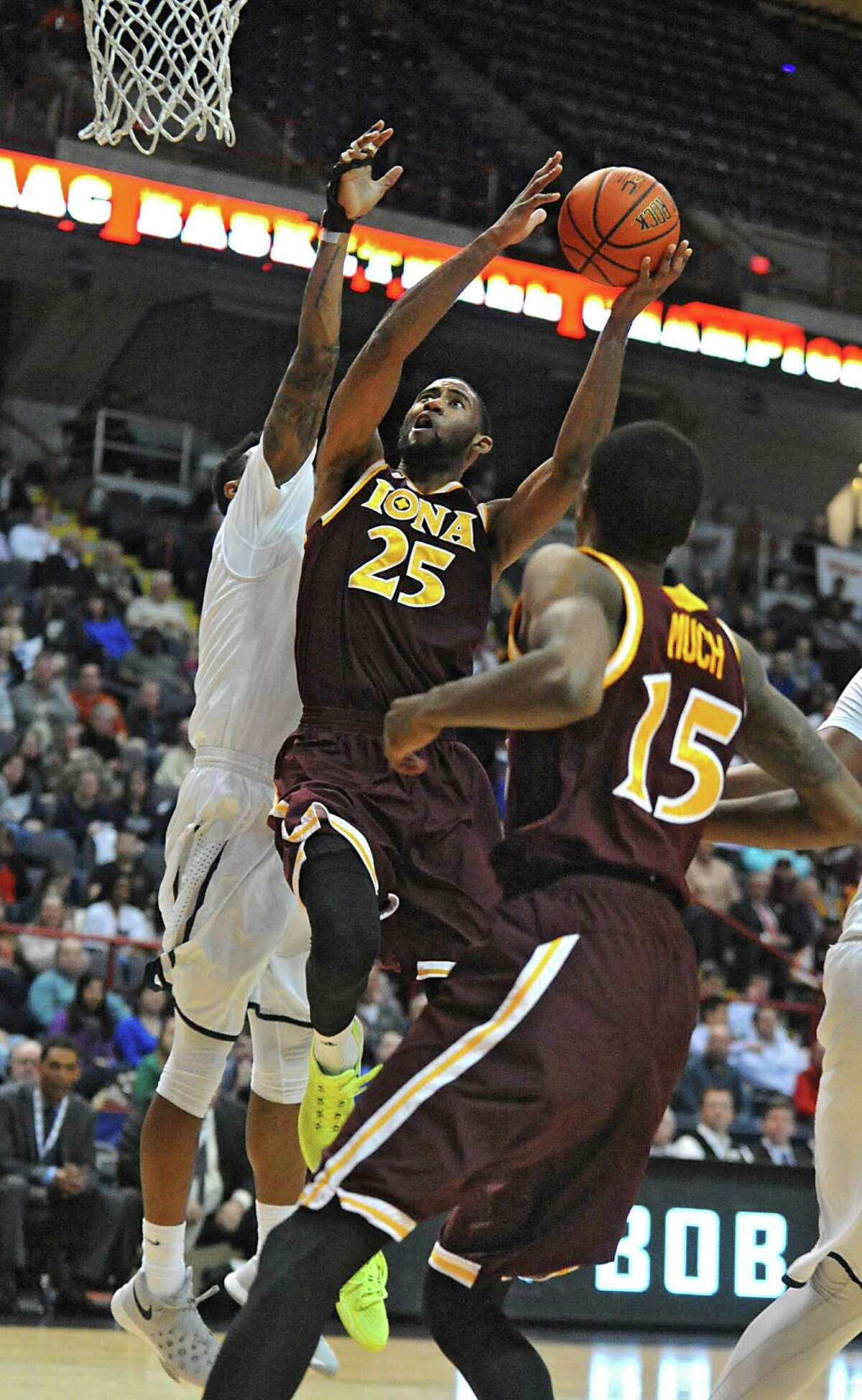 Iona's Aaron Rountree drives to the basket against Monmouth during the MAAC men's championship game at the Times Union Center on Monday, March 7, 2016 in Albany, N.Y.